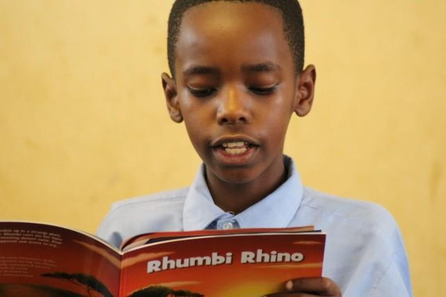 Buhs Babies, Rhumbi Rhino, boy,reading, Balule, SA