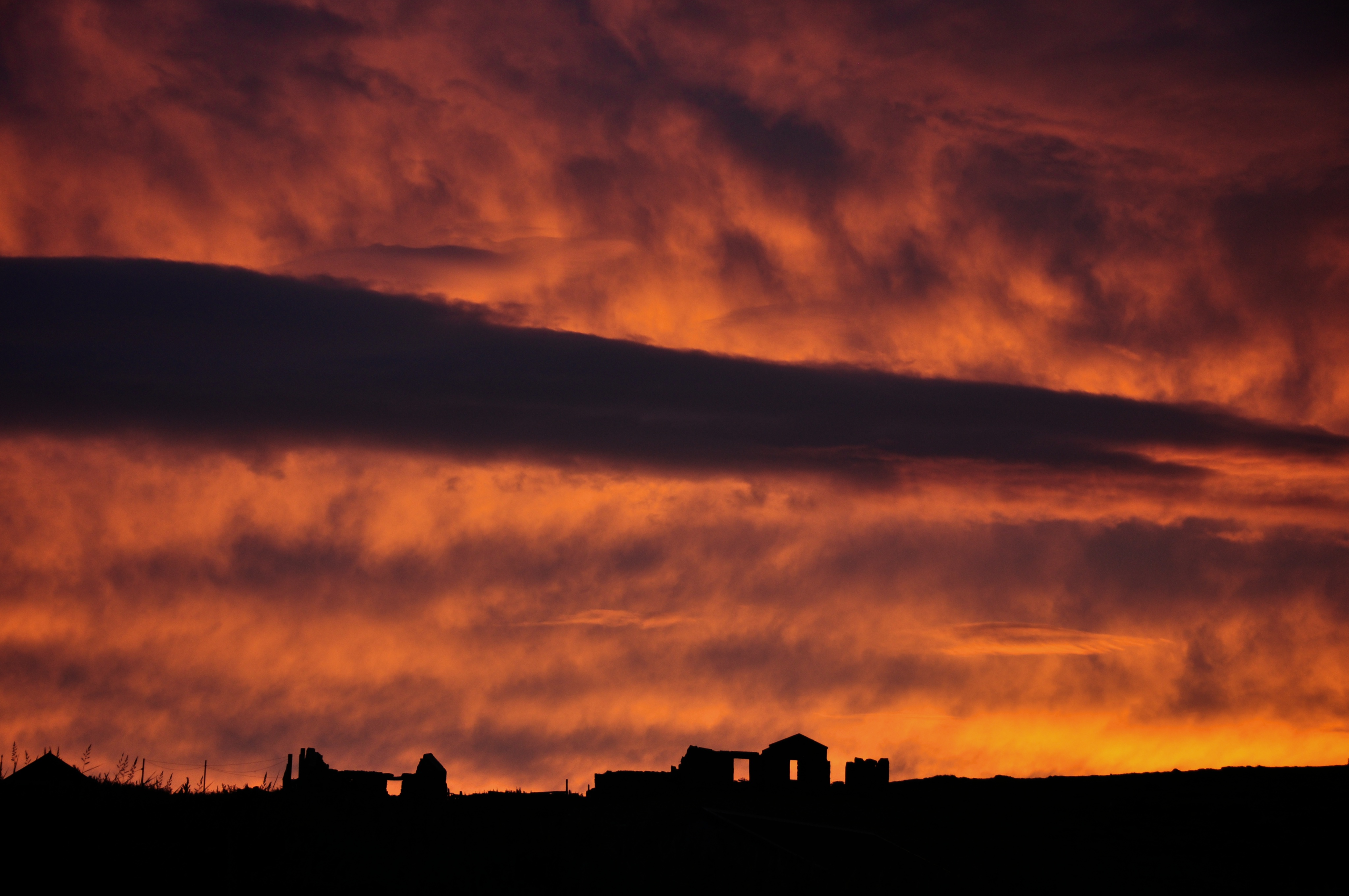 Fiery Sky over Old Croft Houses