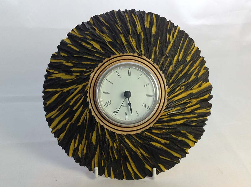 Yellow and black chainsawed clock