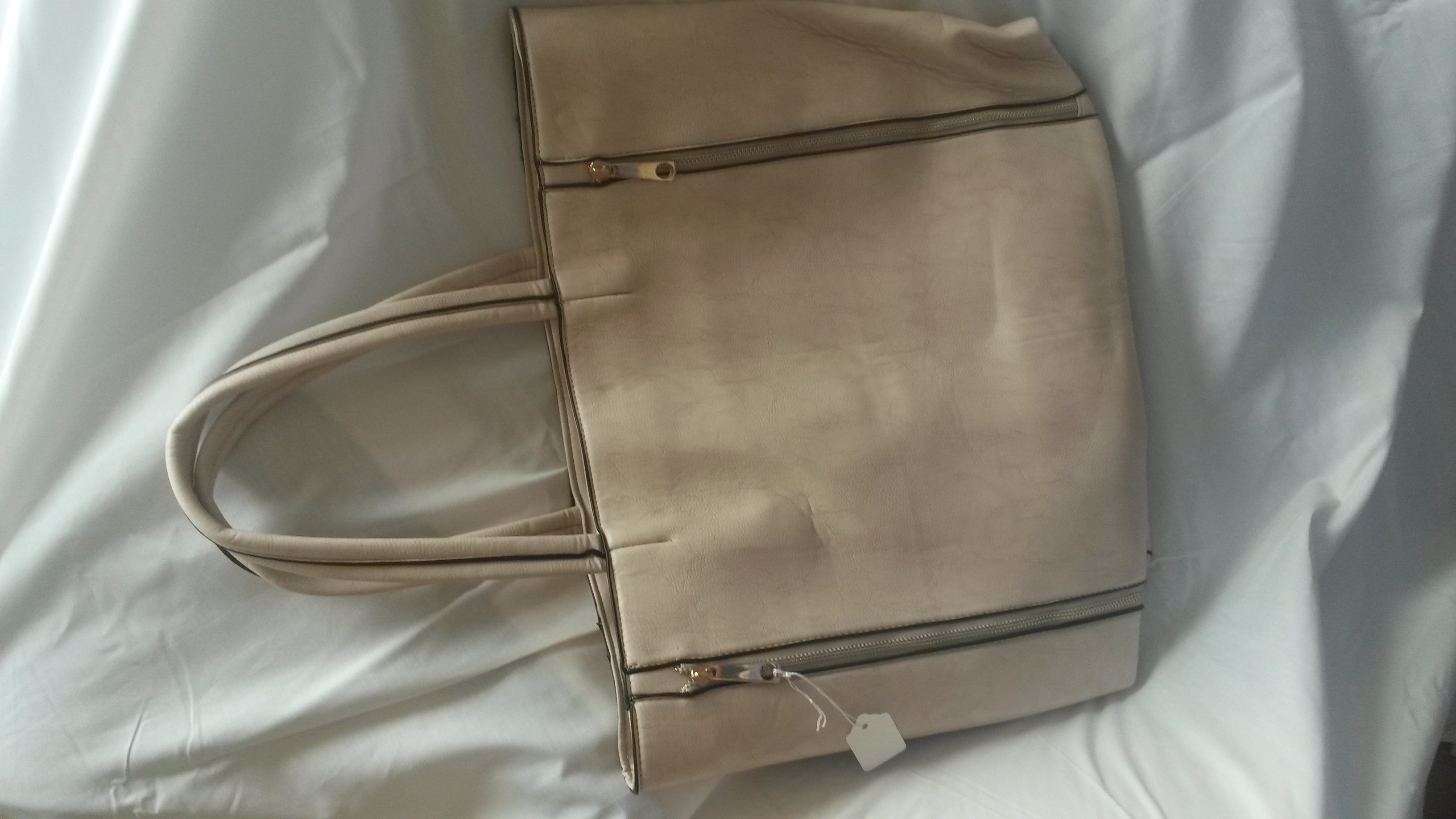 Large cream tote handbag with gold zips