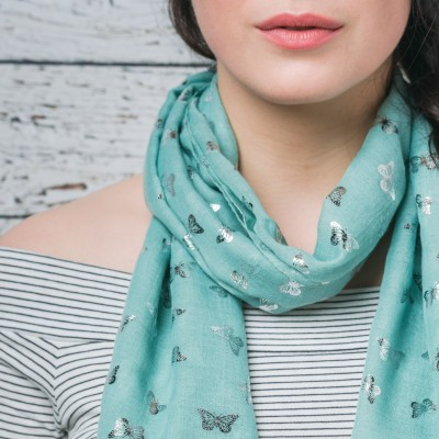 Green scarf with sparkly butterflies