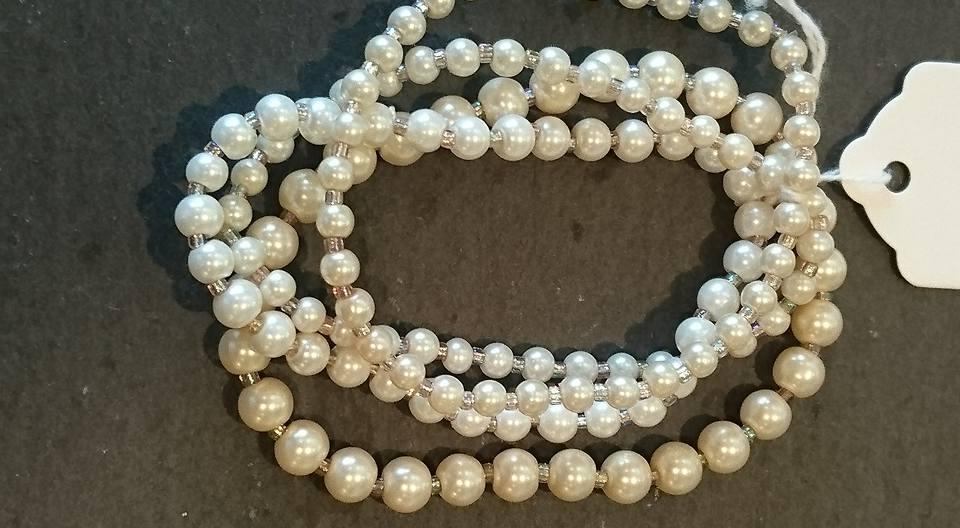 Four strands of mock pearl bracelets