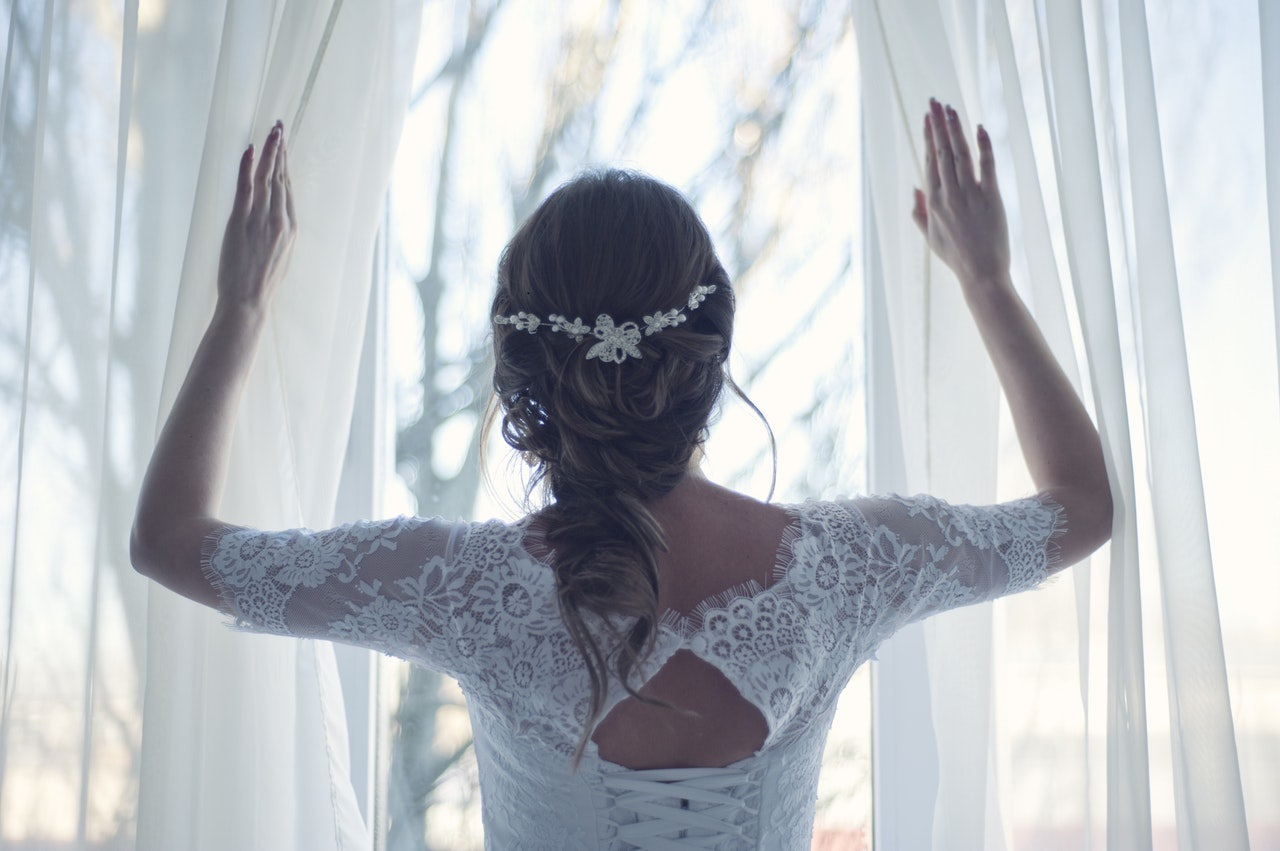 Bride on her rainy wedding day