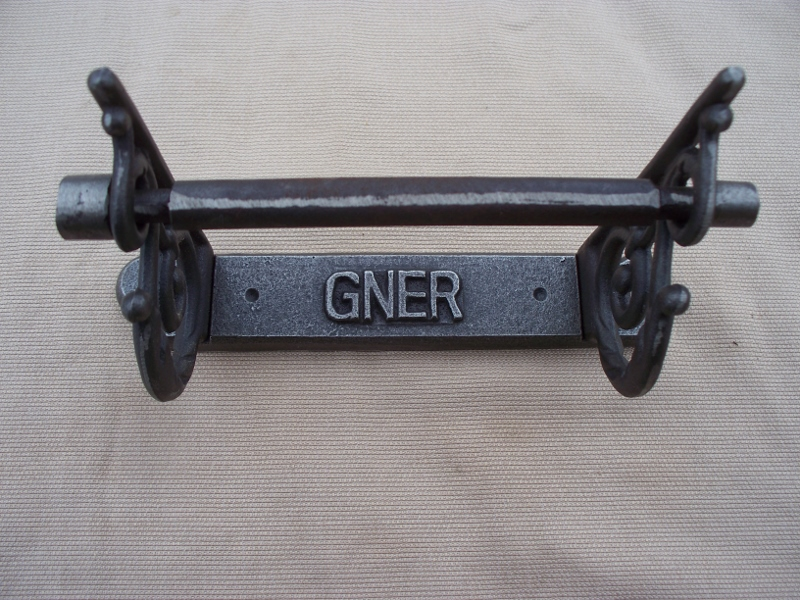 Vintage GNER design toilet roll holder with scroll sides in antique iron finish
