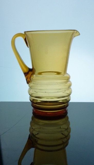 A Whitefriars style amber glass water jug.