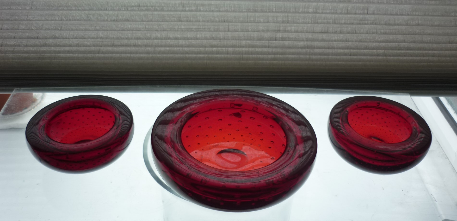 3 pieces of 1960s vintage Whitefriars Ruby controlled bubble bowls.