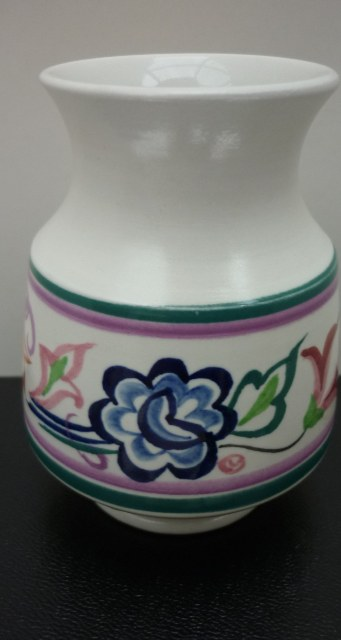 A pretty little 70s Poole Pottery traditional pattern vase