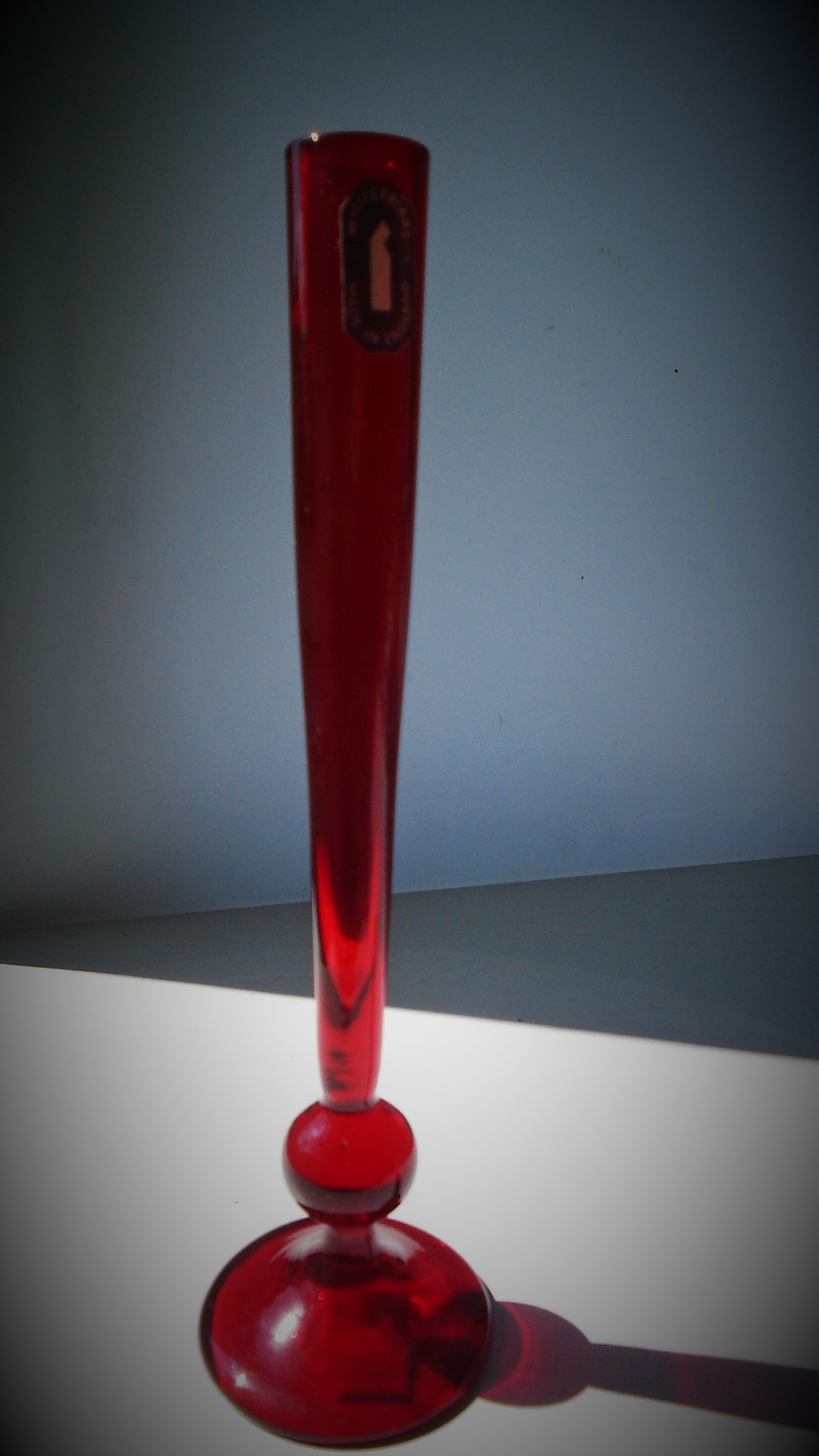 Whitefriars ruby red 19cms high glass stem vase, designed by Geoffrey Baxter in the 1950's, pattern number 9484
