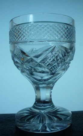 A set of six vintage pressed glass wine glasses