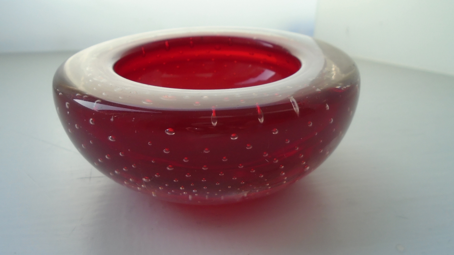 Vintage Whitefriars controlled bubble glass bowl in Ruby. Designed by William Wilson  Catalogue  No.9099