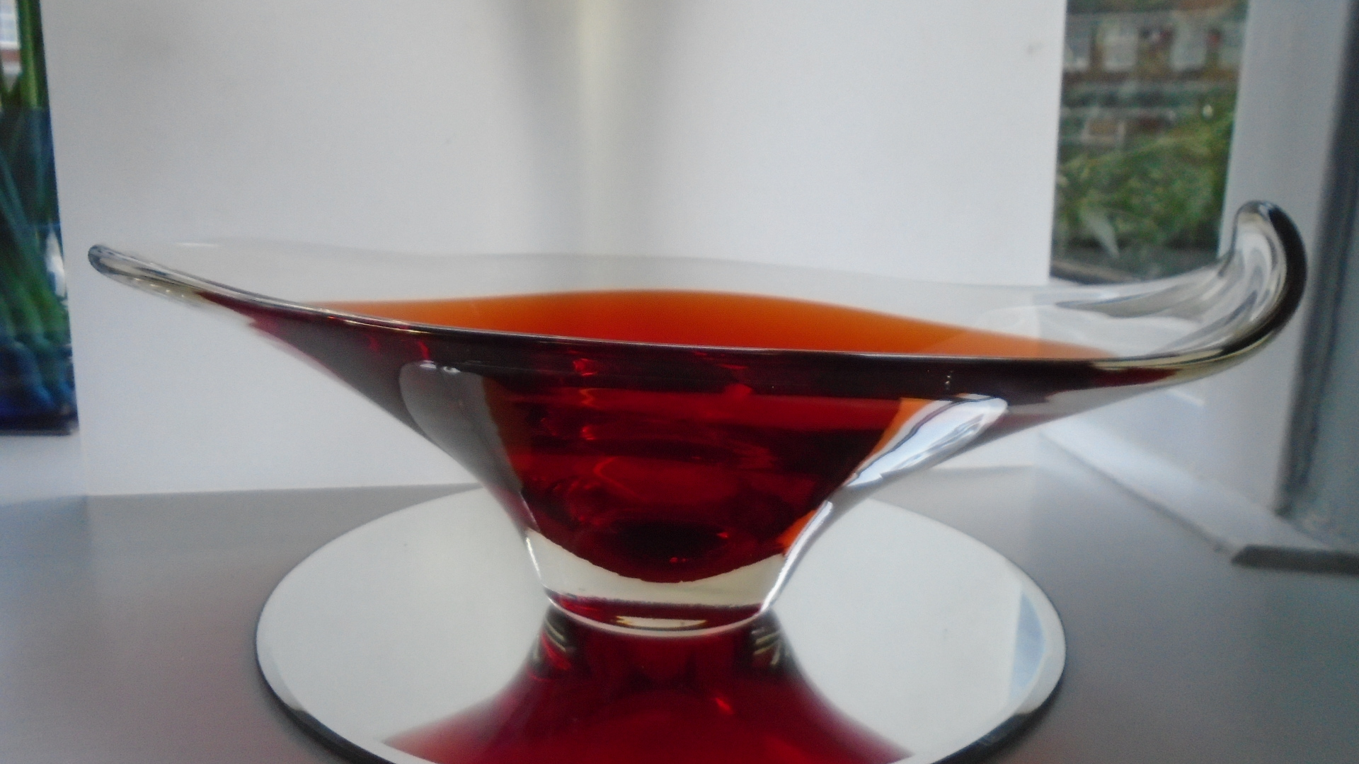 Offered for sale is a fine example of a Whitefriars cased ruby in clear crystal glass bowl by Geoffrey Baxter Pattern 9414.