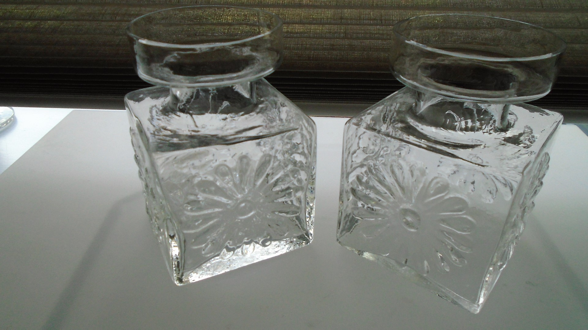 Pair of iconic Frank Thrower 60s vintage Dartington Candle Holders Pattern FT60. in clear with the raised daisy pattern