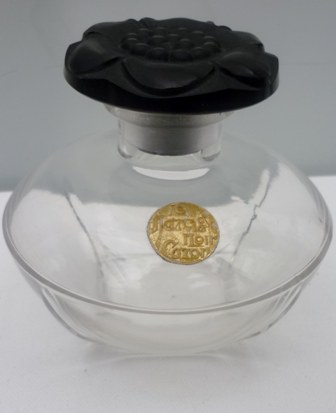 A large 9.3cms high Circa 1911 Baccarat Perfume Bottle.Stunning pressed black glass flower stopper.