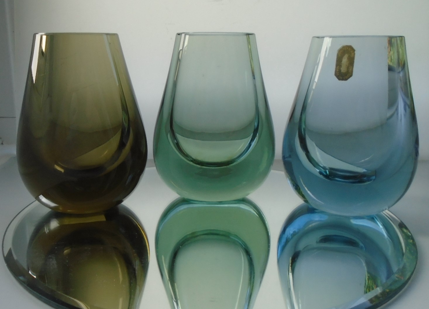 3 Vintage Geoffrey Baxter 60s and 70s Whitefriars Vases of similar design and shape.