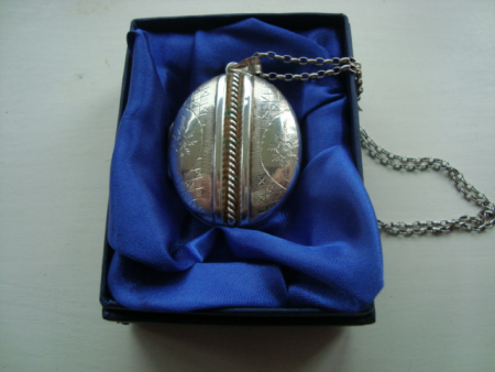 A stunning Vintage 925 Silver engraved and embossed  Locket and Chain.