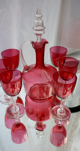 Victorian Cranberry Glass Decanter and six wine glasses.