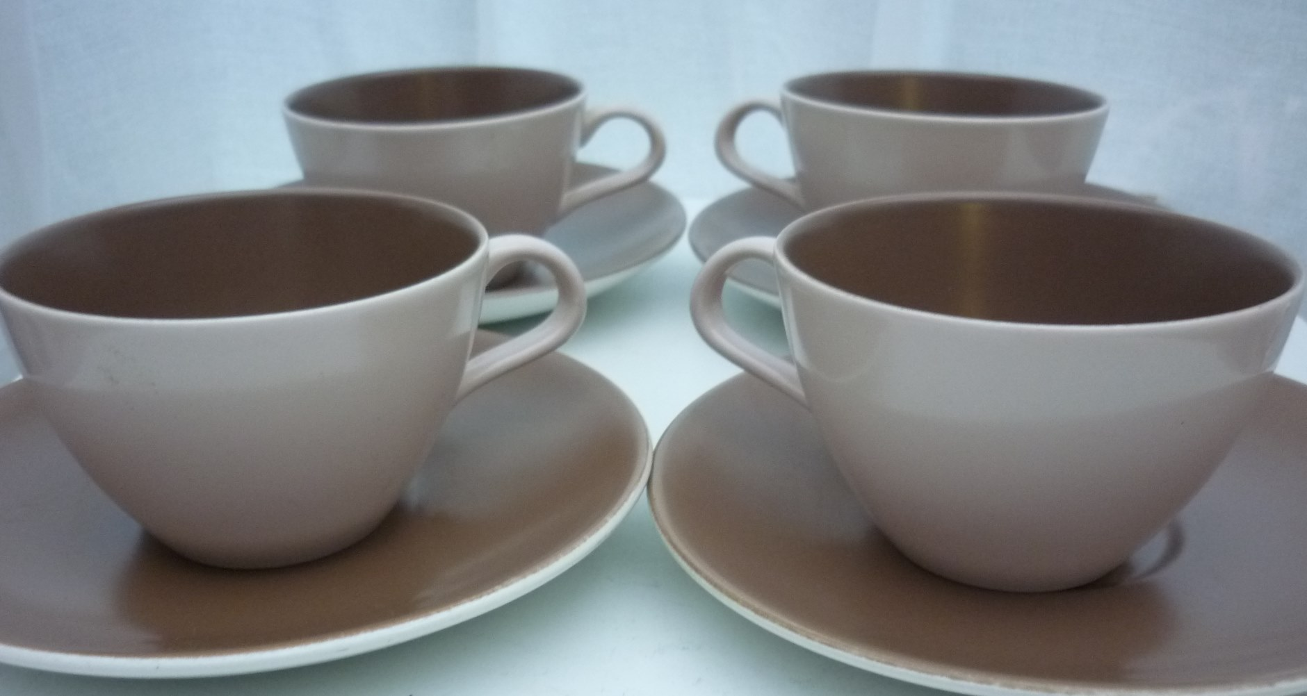 A set of 4 No. 60s vintage  Mushroom and Sepia Tea Cups and Saucers.