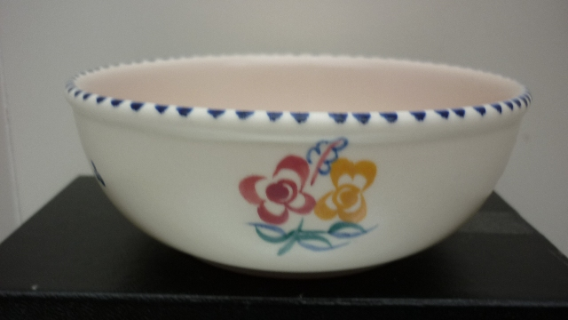 A 50s Vintage Poole Pottery traditional sprig pattern bowl.
