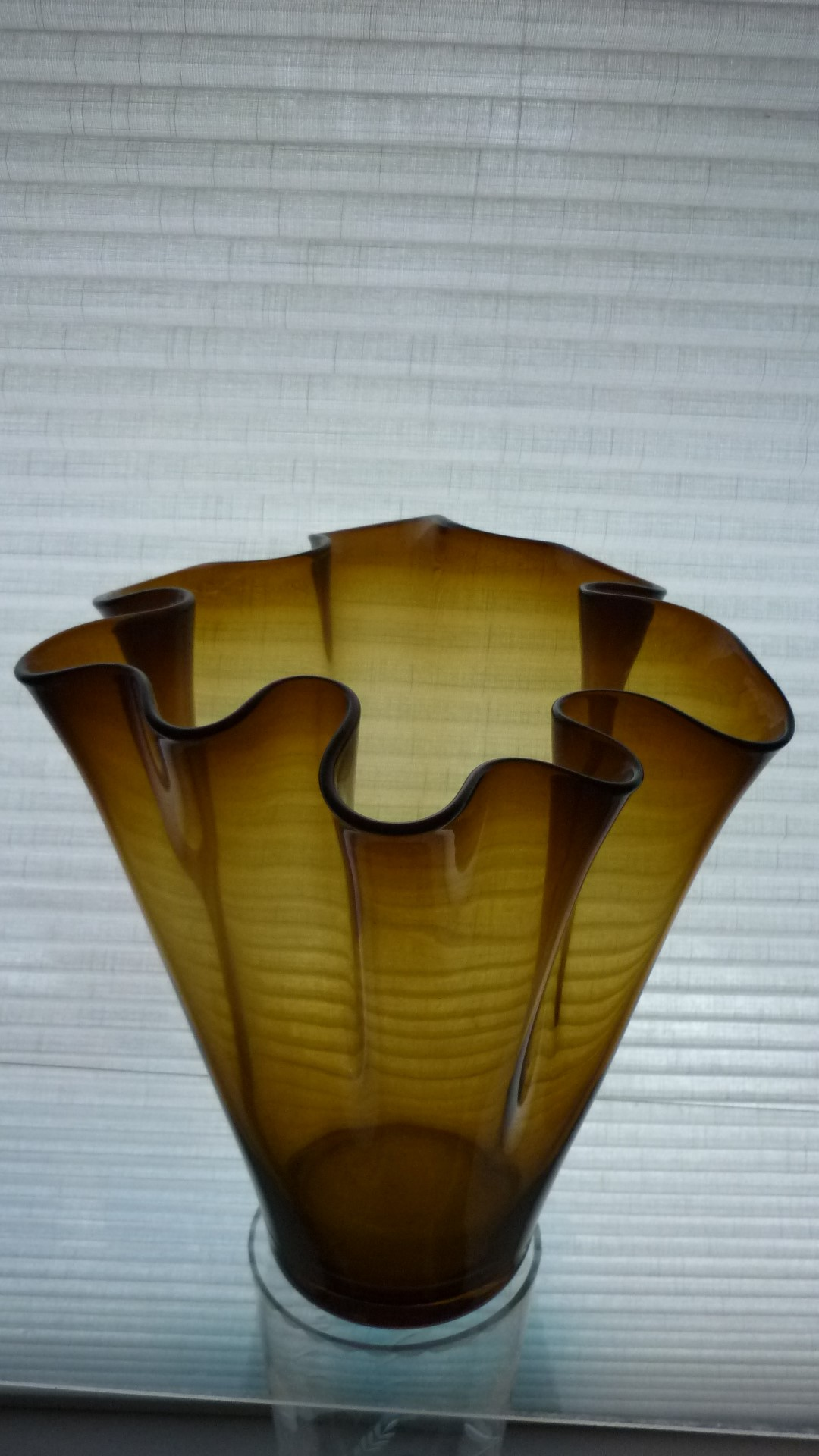"""A beautiful Murano amber glass Fazzoletto or """"handkerchief vase"""", dating back to the 1960s."""