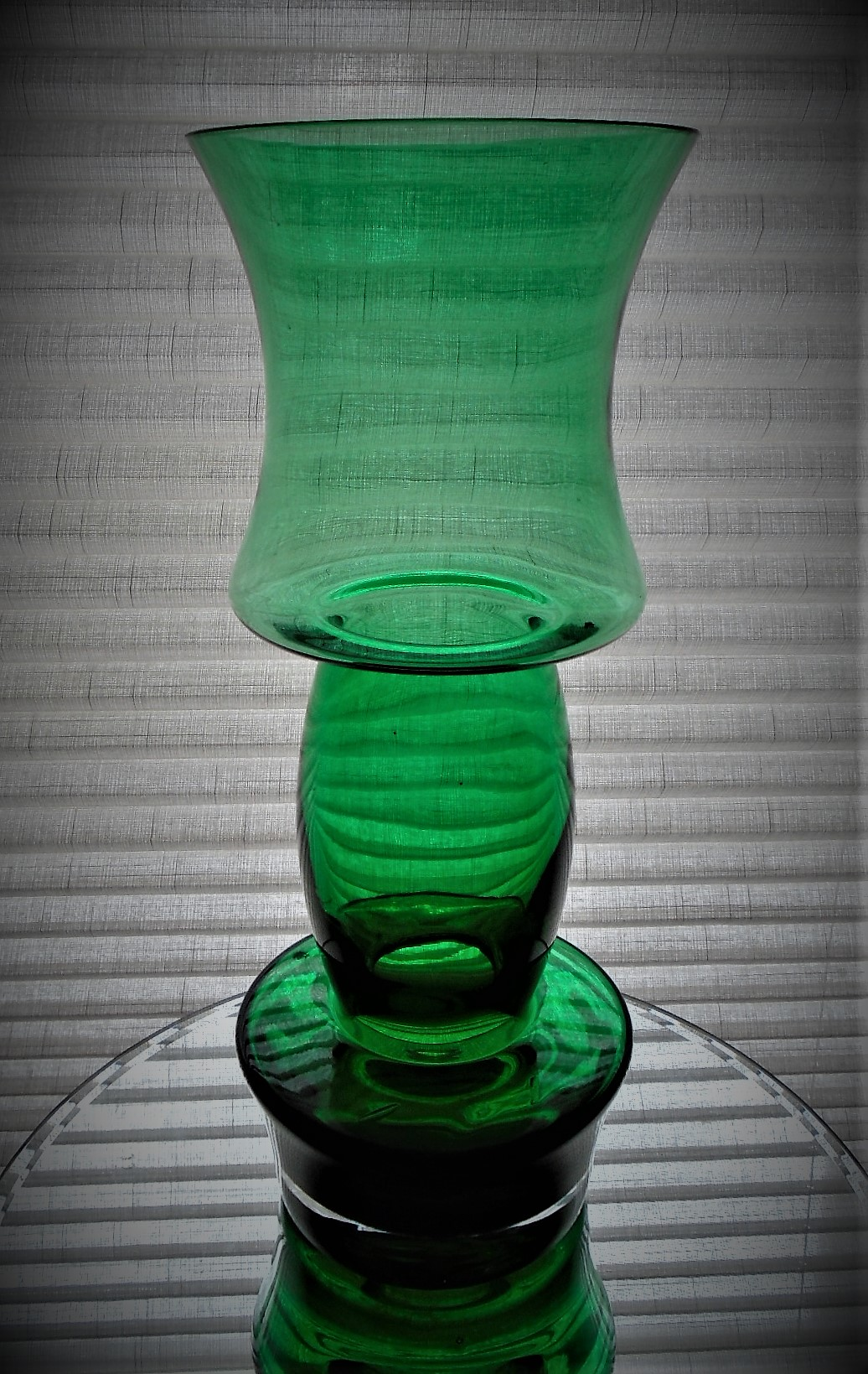 Finnish 1970s RIIHIMAKI  LASI OY  green glass vase by TAMARA ALADIN. It stands 27.9cms in height and has a rim