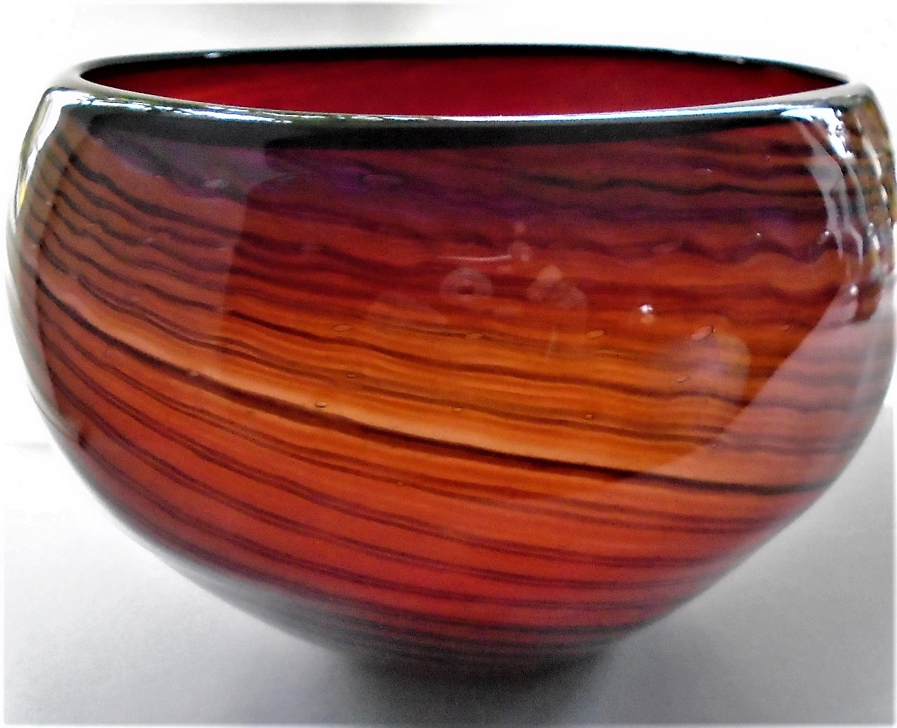 Stunning large 60s MURANO GLASS BOWL with encased spirals of reds and oranges.
