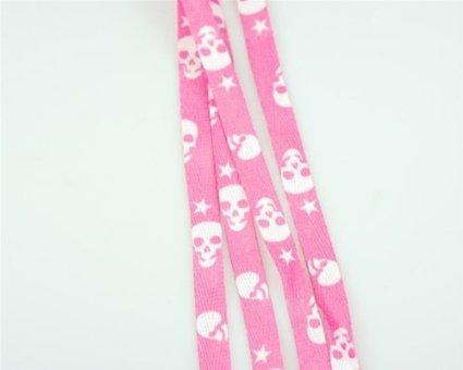 Lacci rosa con teschi bianchi