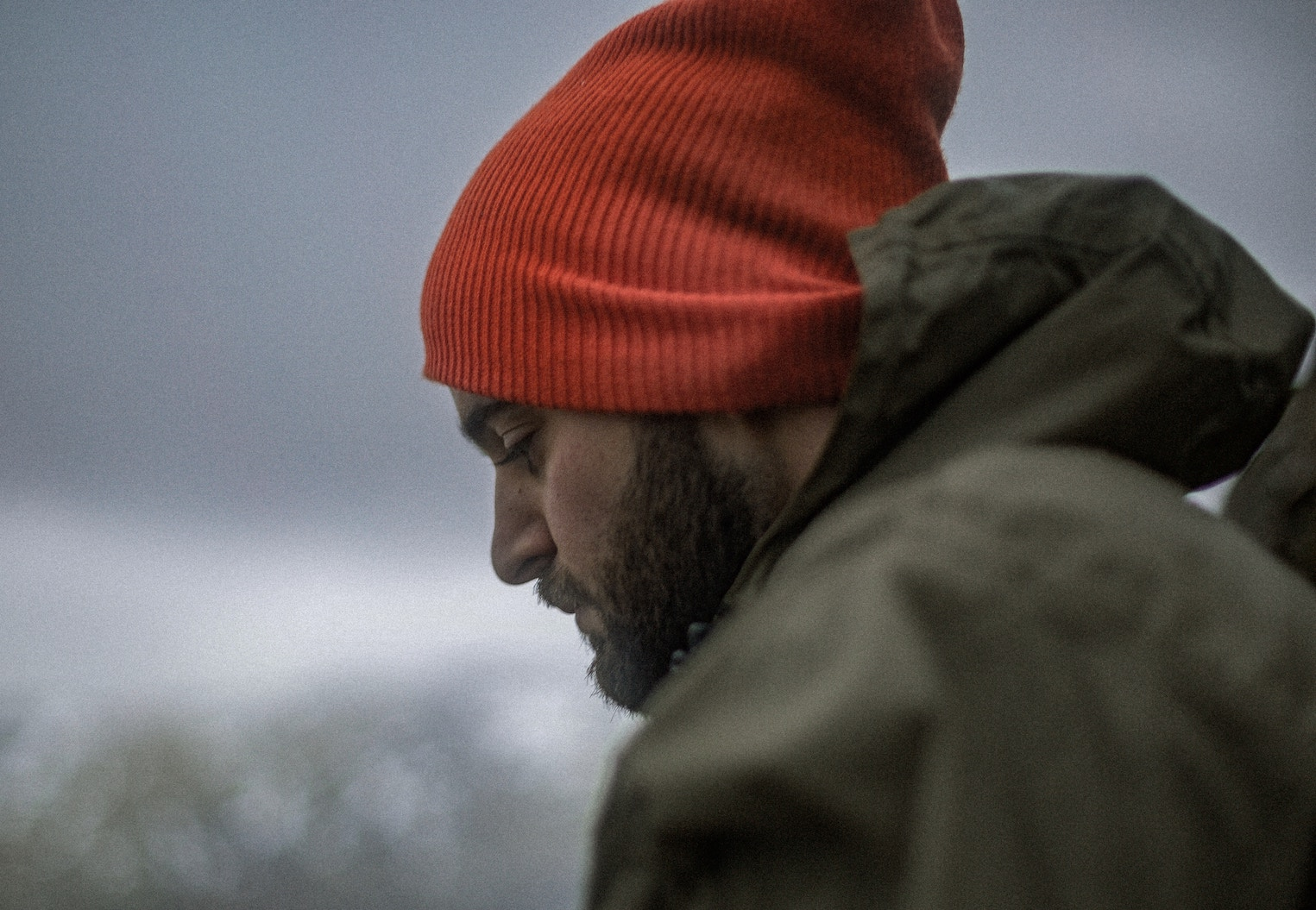 Man in outdoors wearing beanie and big coat