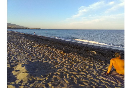 photo_of_empty_beach_during_sirocc