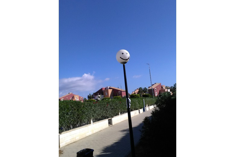 photo_of_a_lampost_with_a_face_painted_on_it
