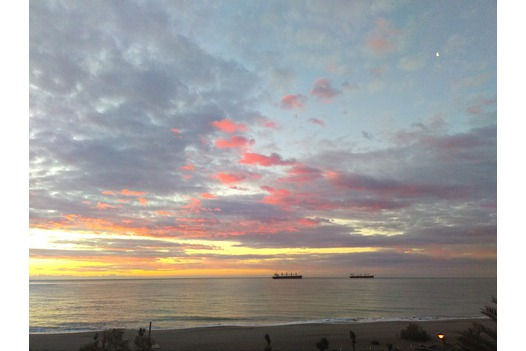 photo_of_blobby_looking_sky_over_the_beach