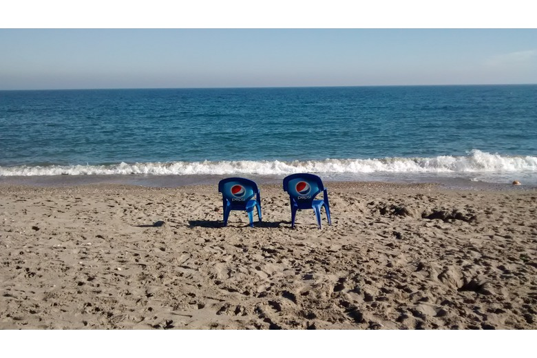 photo_of_empty_pepsi_branded_chairs_at_beach