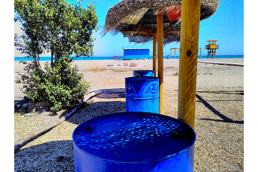 fun_blue_painted_old_oil_barrels_with_marine_art