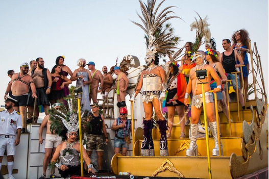 revellers_dressed_up_in_outfits_on_gay_pride_float