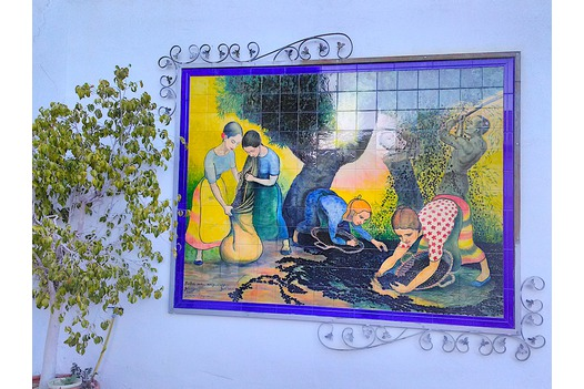 a_tiled_and_painted_mural_depicting_olive_pickers