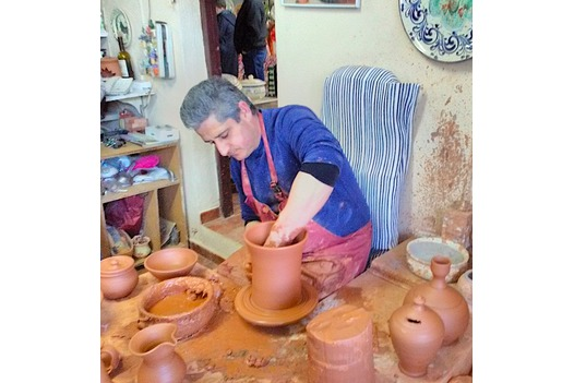 a_craftsman_making_clay_pot_on_clay_turning_wheel