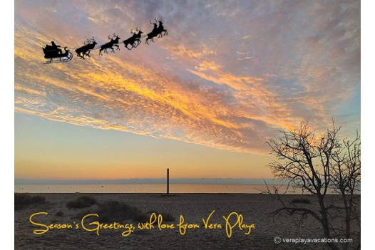 sunrise_over_sea_with_santa_and_sleigh_in_the_sky