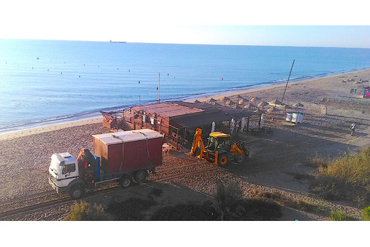 taken_from_above_tractor_on_beach_removing_hut