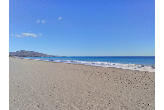 photo_of_vera_playa_beach_with_blue_skies_and_sea