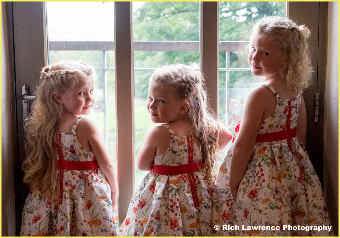 Three bridesmaids looking out of window