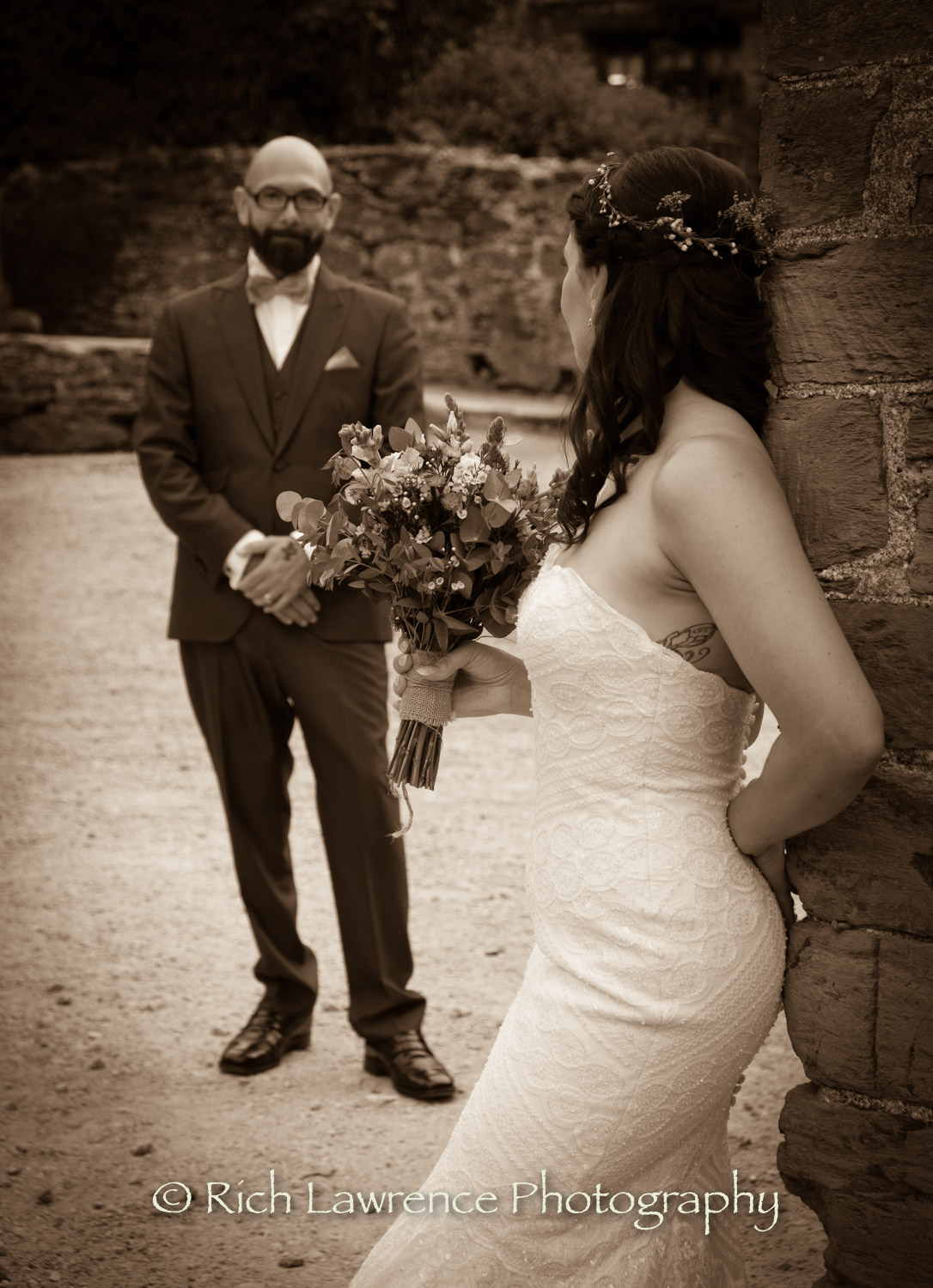 bride and groom pose black and white