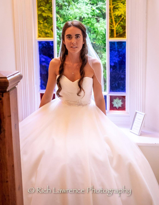 bride sitting in a window