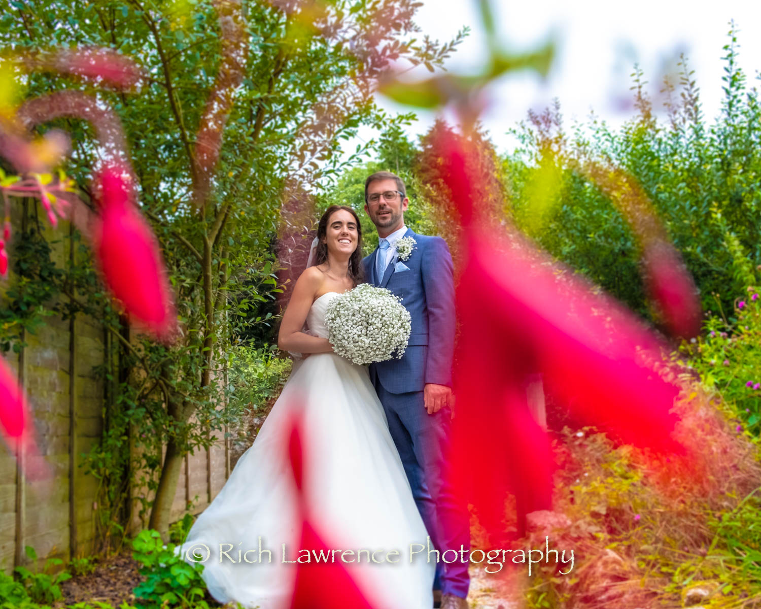 bride and groom pose in gardens