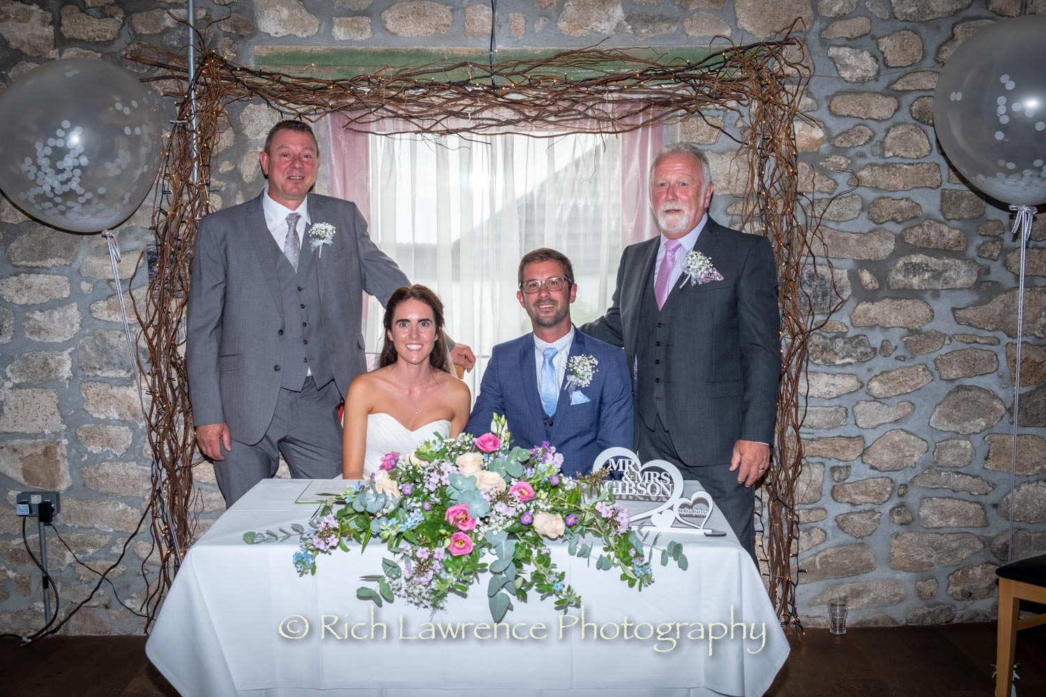 bride, groom and witnesses pose