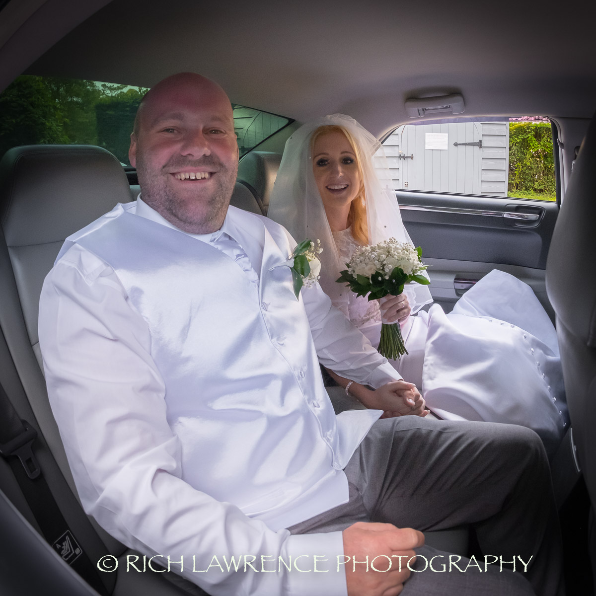 bride and groom in limmo