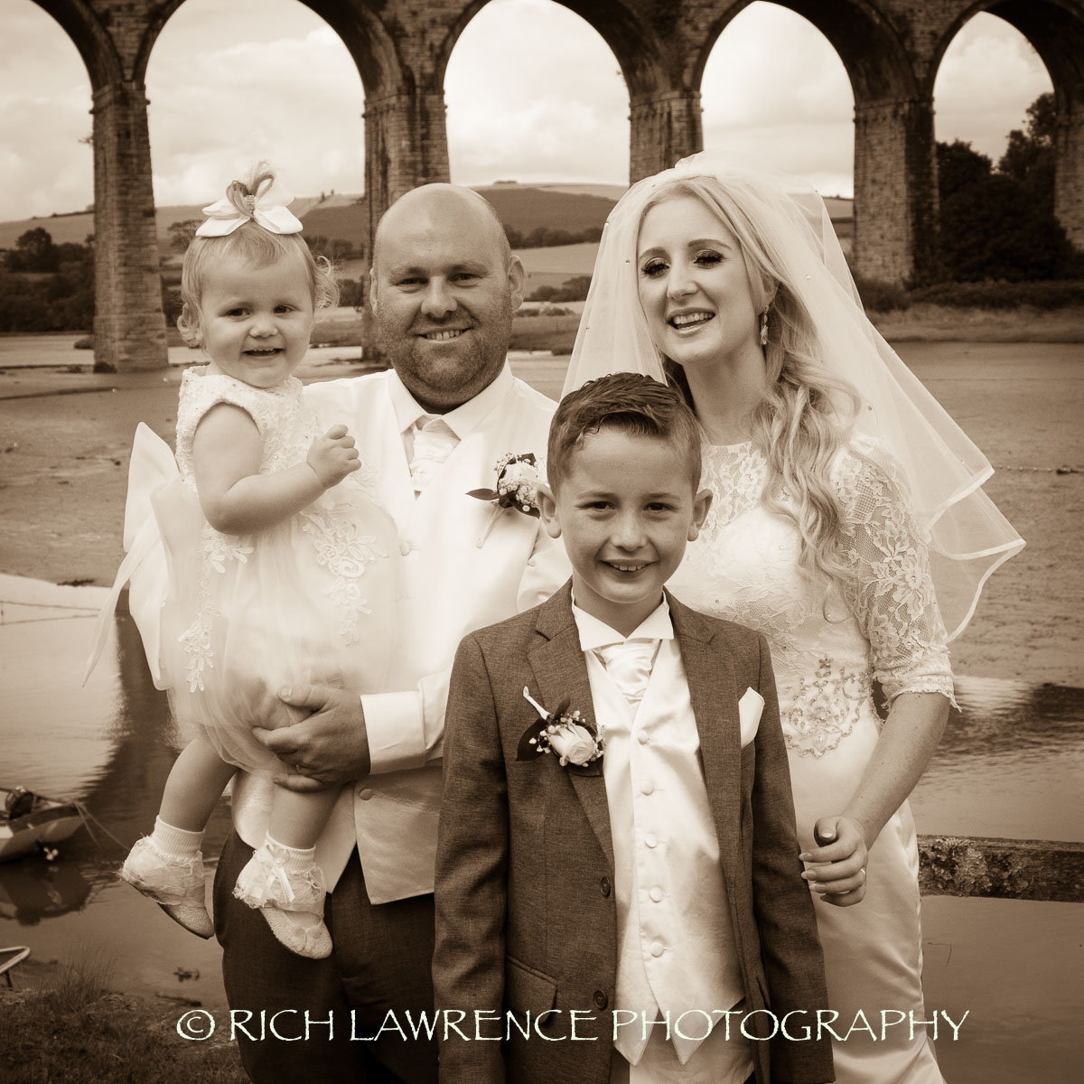 Bride and groom with children pose for camera