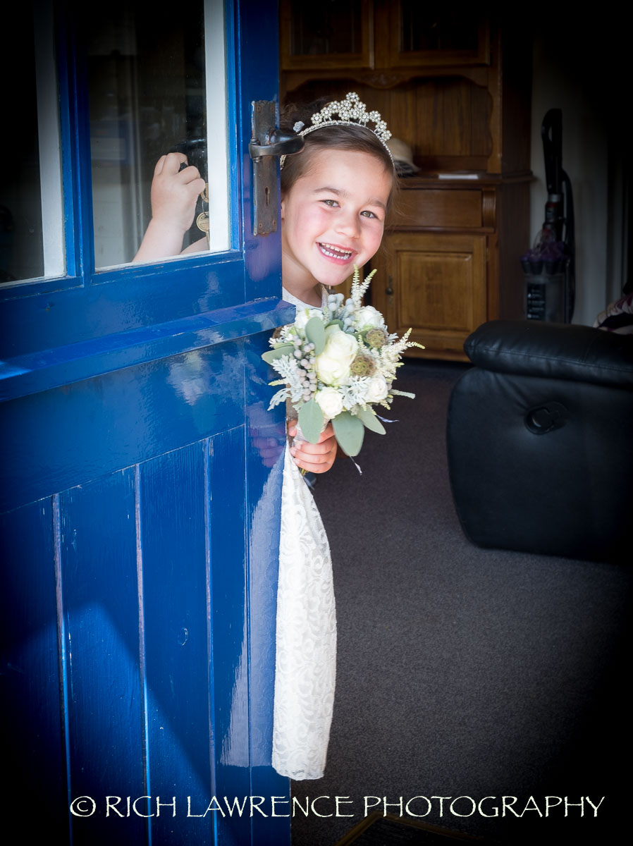 Bridesmaid peeping behind door