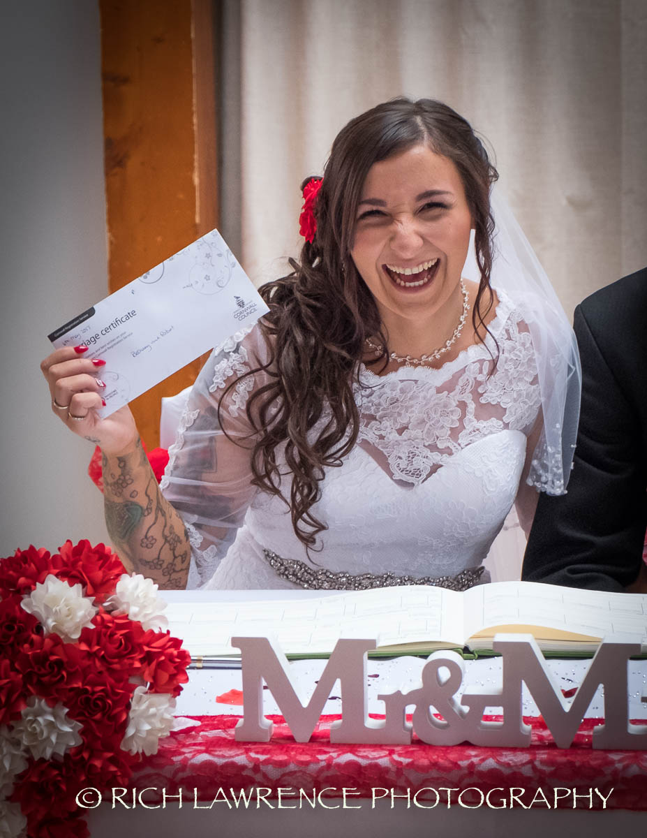 Happy bride with wedding certificate