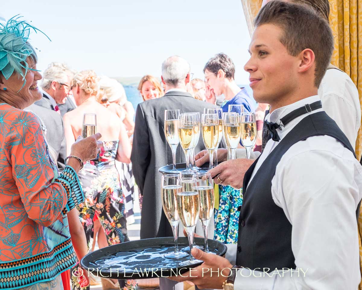 Barman offers wedding guest a drink