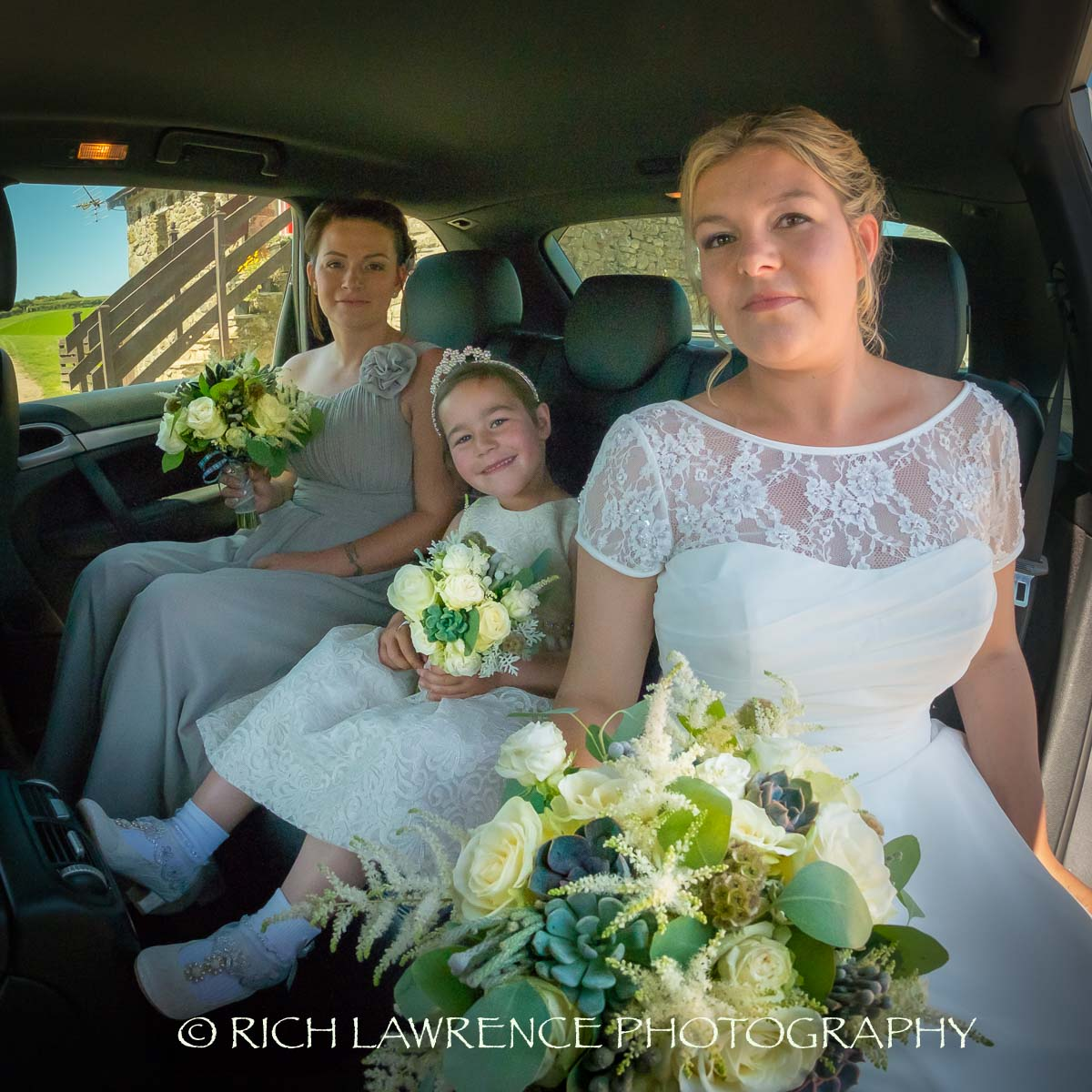 Bride and bridesmaids in car
