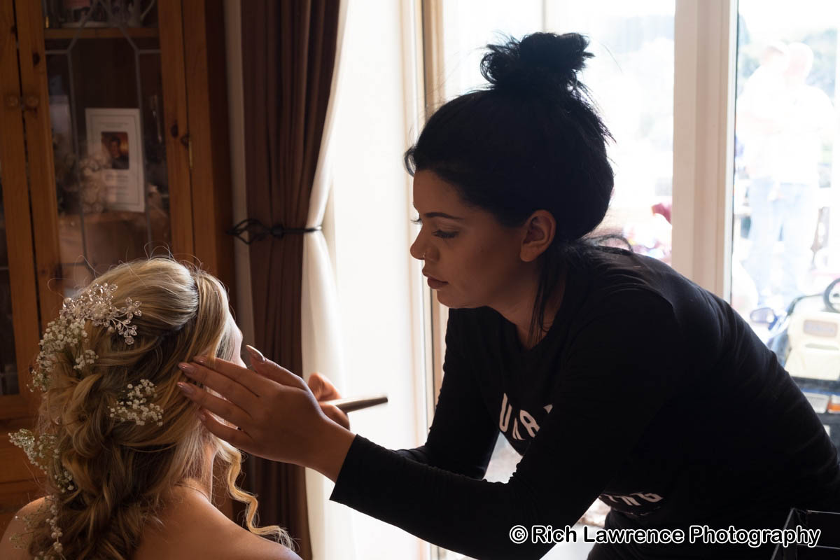 Bride having make up put on